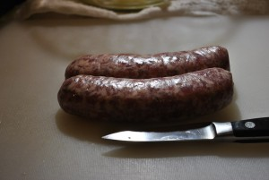 two sausages with paring knife